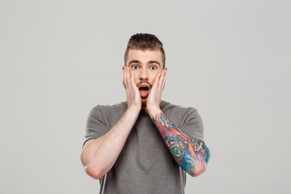 Surprised Young Handsome Man Posing Grey Wall